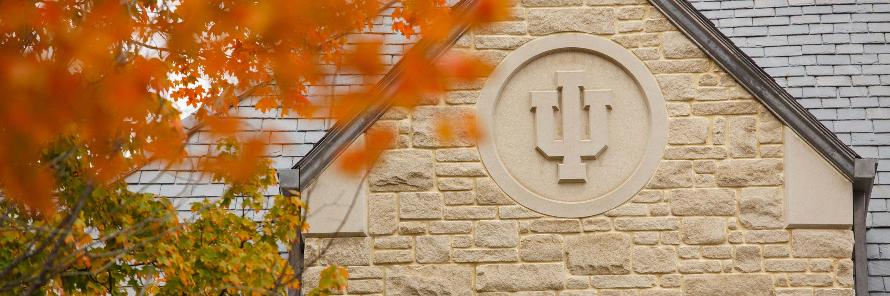 Indiana University seal carved into the side of a building